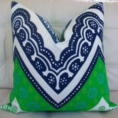 Mix of Kelly green with Navy and White...I guess you really are supposed to punch the pillow...lol