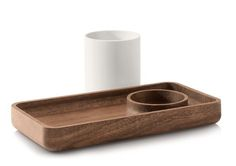 """The most challenging aspect of the design was bringing together the wood and plastic, Pfeiffer says. """"The intersection of these two dissimilar materials requires tight tolerances between two materials that move at very differently rates. It took some time to getting this right!"""" The cup on the Catch All Tray ($45) can be used atop the tray or removed to reveal a spot to corral smaller items."""
