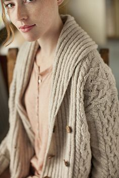 From Brooklyn Tweed, pattern 'Exeter' cabled shawl collar cardigan by Michele Wang.  $7.00 PDF download  http://brooklyntweed.net/store/index.php?main_page=product_info&cPath=2_3_18&products_id=112