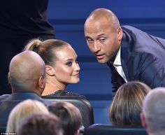Cute couple: Derek Jeter leans into girlfriend Hanna Davis as he accepted the Icon Award...