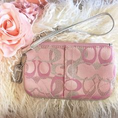 Pink Coach Wristlet Cute pink Coach wristlet which is in good condition. Never been used. My price is firm. No trades. Coach Bags Clutches & Wristlets