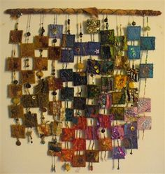 Quilting - this is such a cool idea.  This example is a fabric wall hanging, but since fabric in this venue is hard to clean, I would use other mediums that could easily be dusted or surface washed.
