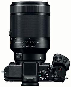 The Nikon 1 Nikkor VR lens is finally in stock - Nikon Rumors Nikon Digital Camera, Camera Nikon, Camera Gear, Nikon 1, Digital Cameras, Camera Hacks, Camera Tips, Photo Lens, Camera Equipment