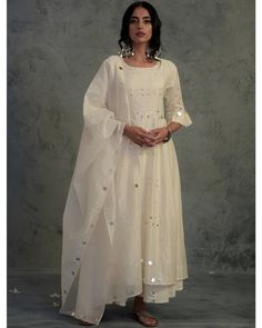 Ivory chanderi kurta set with pleated mirror embellished sleeves and mirror work on front panel. Look for the Ivory Chanderi Pleated… Pakistani Dresses Casual, Indian Gowns Dresses, Indian Fashion Dresses, Dress Indian Style, Pakistani Dress Design, Indian Designer Outfits, Indian Designers, Stylish Dresses For Girls, Stylish Dress Designs
