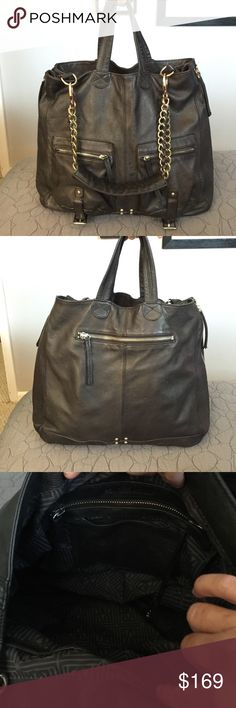 Pour La Victoire Black Leather Satchel Exquisite Pour La Victoire large leather shoulder bag.  This beautiful leather bag is large enough for all your needs.  There are two pockets on the front and a zippered pocket on the back as well as a large zippered pocket inside.  The side of the bag has zippers to expand the bag even more. The hardware is a little tarnished but all in working order.  Clean inside and out. Pour la Victoire Bags Satchels