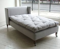 Christopher Howe Daybed with a custom mattress cushion in a traditional ticking fabric.