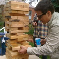 "To make a DIY outdoor version of Jenga get out some 2x4's and cut them into approx 10 ½ "" long pieces. Once you have 54 pieces, sand them up a little, stack 'em, and challenge everyone to a match!    Our favorite bar has one of these on the patio -- giant jenga! Super fun!"