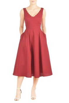 Cotton poplin is shaped into our scallop trimmed dress styled with a wide V-neckline, princess seamed bodice, banded high waist and full skirt for a flattering silhouette.