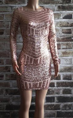 This dress is absolutely stunning in one of this seasons hottest colors and design. This dress has you covered from holiday parties to New Year's Eve...maybe even Valentine's Day! Color: Rose Gold. Fa