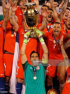 Claudio Bravo of Chile raises the Copa America Centenario Trophy with his teammates behind him following the championship match between Argentina and Chile at MetLife Stadium as part of Copa America Centenario US 2016 on June 26, 2016 in East Rutherford, New Jersey, US.