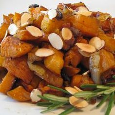 Roasted Sweet Potatoes. Was yummy!  Roasted the yams the day before in skins, the peeled  and cut them.  caramelized the onions the day before. used less onions by half. cooked the dish the next day.  Worked well.