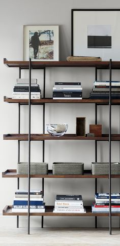 Expansive Shelving Anchors Family Room Office Or Kitchen With Open Styling That Puts Books And