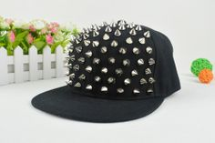 This item is for adults The perimeter is between 57-60cm, peak is about 7cm, has plastic buckle on the back. The silver spikes are made of plastic, not metal, please note!!! Condition: New Material: Cotton blend