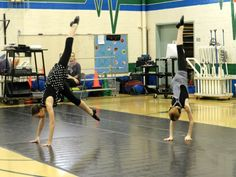 Two of our level E students dancing in an outreach at a local elementary school