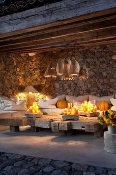 One of the beautiful outdoor lounging areas in Sonoma~ Love the hanging basket lanterns, splash of yellow, and the coffee table constructed of old beams.