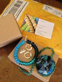 Look at what I received from my Bead Soup Blog Party partner, Jodie Marshall! Jodie is a lamp work bead creator and fabulous beader! I love the colors of the soup she sent me, don't you?!?