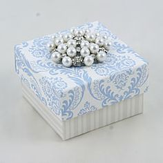 Vintage style wedding favor box in blue and white.