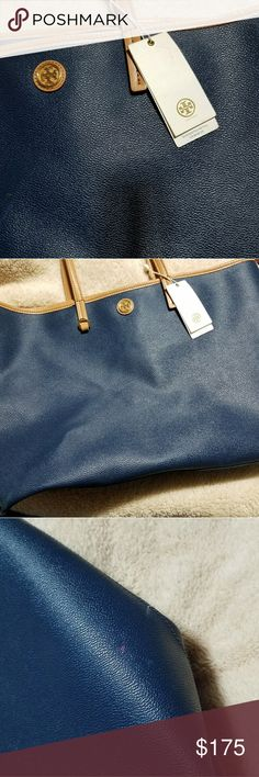 Tory tote purse Tory tote navy blue, tan straps ...some use w/original tag. small paint mark pictured. Tory Burch Bags Totes