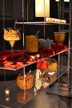 This popcorn bar is suspended from above. This is such a modern and different way to use a buffet line! By Brancato's Catering and All Seasons Event Rental.