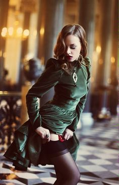 Love the red garter & black stockings with the green dress...