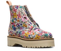 We took the rugged commando tread and military style of the jungle boot, and put a feminie spin on it. The result? The Sinclair, a 8-eye women's boot with tons of tough Doc's attitude contrasted by a sweet floral print called Wanderlust. The boot includes two ways to fasten — laces and a zipper — plus puritan stitching on the toe-cap and a chunky, empowering platform sole. Made with lightweight canvas, printed with a 90s archive print: Wanderlust Built on the rebelliously comfortable ...