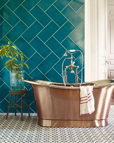 Lovely.    Fired Earth – large green tiles and copper bath. Striking combination.