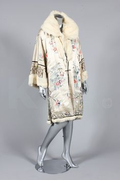 c6bac619f45e An embroidered ivory satin evening coat