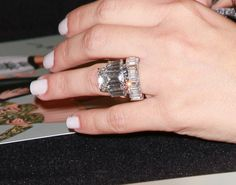 Kim Kardashian's engagement ring is freaking ugly! Way to big and gaudy, marriage isn't about the ring! I hate her she is such an attention/ regular whore!