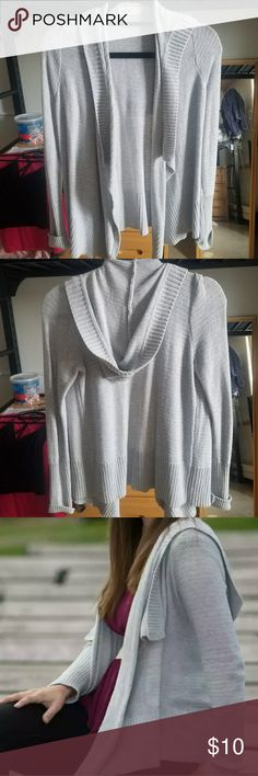 Gray Sweater Cardigan Hollister Very gently worn Hollister gray sweater cardigan with hood size small. No signs of wear. Wore for my high school senior pictures.  Bundle and make offers! Hollister Sweaters Cardigans