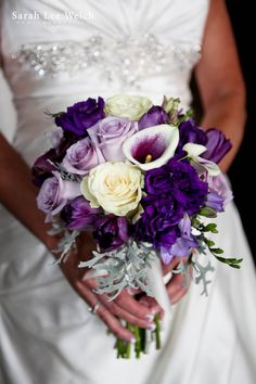 Florals by Rhonda llc purple  wedding bouquet of roses, calla lilies, freesia, lisianthus and tulips. Sarah lee Welch Photography