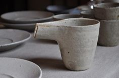 pouring jug, glazed ceramics, firestone, raw and rough soft tones and very natural