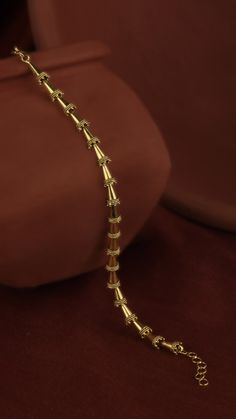 The modern gold bracelet swathes the wrist with lace edged cones. Gold Bracelet For Girl, Mens Gold Bracelets, Gold Bracelet Indian, Gold Jewelry Simple, Gold Rings Jewelry, Women's Jewelry, Gold Jewellery, Pearl Necklace Designs, Gold Earrings Designs