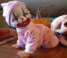 Creepy Clown Horror Doll  Sale.- I might have to redo some of my daughter's dolls that I'm constantly tripping over!