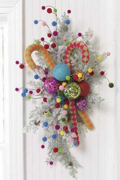 Go bold and colorful with inspiration from Santa's workshop door decoration. #Christmas