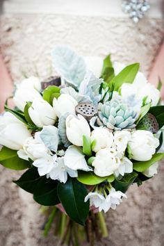 The bride's bouquet was filled with locally grown white tulips, paper whites, dusty miller, camellia foliage, succulents, mini-pine cones and lotus pods.