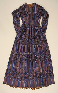 1844-48 Purple, blue & white plaid dress.  Probably American.  Look at the use of the plaid on the bias.  Also, a slight v-neckline.