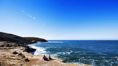 Bushwalkers relaxing on the coastline of Bouddi National Park, Central Coast. Image The Legendary Pacific Coast