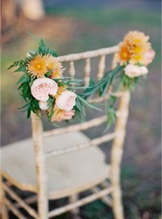 Orange and blush pink floral chair garland | http://burnettsboards.com/2013/12/gold-patina-colored-wedding/