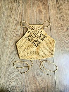 The Three Flowers Crop Top is the perfect crochet summer top, either for a festival, going to de beach, or just looking cute! This listing is for the PDF crochet pattern only. It is comes in US terms and with lots of very helpful pictures and charts. Level: Easy - Intermediate Crochet