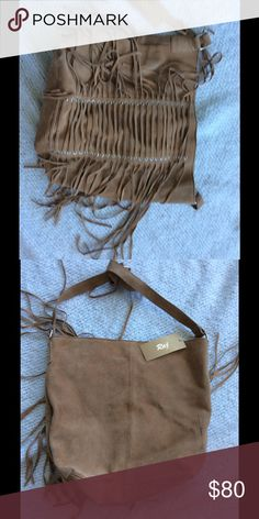 Beautiful Brown Leather Fringe Hobo Bag This gorgeous bag is all leather, has darling on-trend fringe detailing, and is cinnamon brown. I bought this bag for myself and never used it so now someone else can enjoy it! ☺️ Raj Bags Hobos
