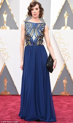 March of the blue belles:Lara Spencer (L) andChloe Pirrie stood out for the occasion in ...