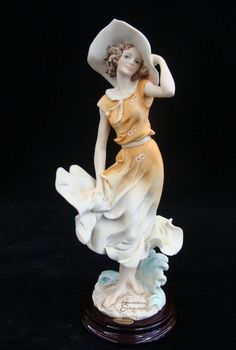 April by Giuseppe Armani. #121-C, 1997 Figurine of the Year.  from LiveAuctioneers.com