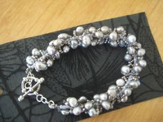 Bracelet with Grey freshwater pearls and silver seed beads and sterling silver clasp.