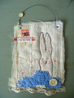 bobby the bunny by Hen's Teeth. Is a whole line of similar little art quilts,etc.