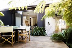Courtyard: Robert Plumb Project built a custom designed floor to ceiling, glass door for the area opening onto the terrace that was cleverly designed to open fully, leaving a completely blank and frameless opening. robertplumb.com.au William Dangar designed the courtyard to be lush and abundant, using large banana palms and Australian natives, creating a space with an amazonian aesthetic. http://www.williamdangar.com.au
