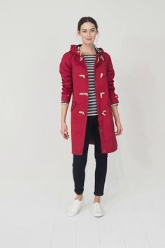 Seasalt mid-thigh length ladies' windproof and breathable waterproof coat with zip, toggle and rope fastenings, pockets, adjustable hood and cotton lining.