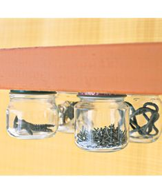 """ Use Glass Jars to organize: Nail or superglue the lids to the underside of a surface near where you store your tools, then twist the jars into place. Put like-size nuts and bolts in one jar, wood screws in another, nails in another. Also attach an empty jar so that when you're working on a project, you can gather the necessary hardware and stow it there."""