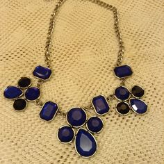 Statement necklace Never worn statement necklace, silver looking adjustable chain, dark blue and black stones Uncommon Jewelry Necklaces