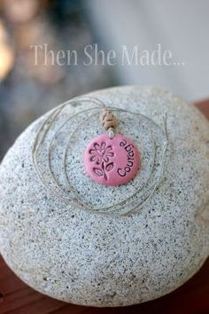 ake the bead that sits at the top of the pendant.  Do this by shaping a small piece of clay into a small ball.  Then shape into the desired form for a bead.  Next, poke a hole through the center.  Make sure the hole is big enough that your twine or hemp can thread through it.