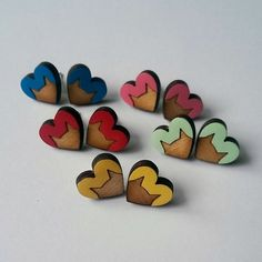 These lovely little cat heart earrings have been laser cut from thick Birch Plywood . Hand painted in a choice of 5 colours: Red, Blue, Pink, Yellow and Mint Green- please specify which you would like on ordering. Earring posts are silver plated, . Heart Earrings, Stud Earrings, Mint Green, Pink Yellow, Blue, Wood Cat, Birch Ply, Wooden Earrings, Wooden Hearts